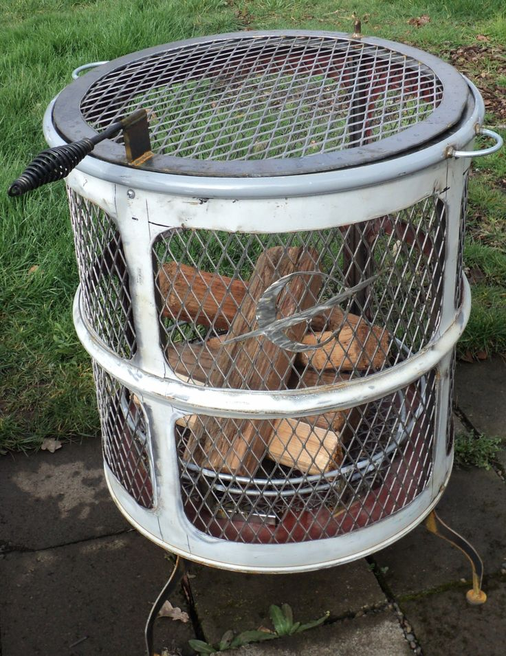 Fire Pit by  -- Homemade fire pit constructed from a 55-gallon drum, steel plate and tubing, and expanded metal mesh.  http://www.homemadetools.net/homemade-fire-pit