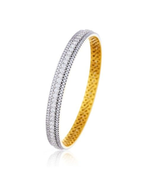 When gorgeousness meets purity, you get a gorgeous #sparkle like this. The finest Belgium diamonds are cut, designed and set to create classy #diamond #jewellery. #designer #bangles #gold #diamond