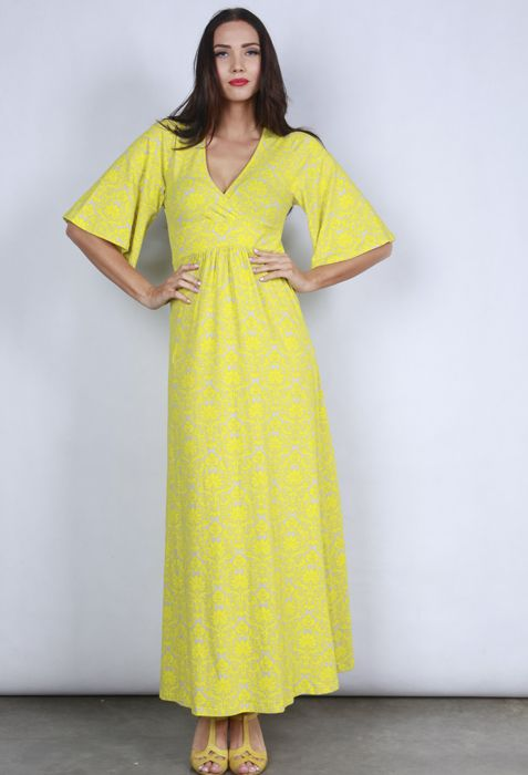 Wrap Front Maxi Dress With An Elbow Length Bell Shaped Sleeve In A