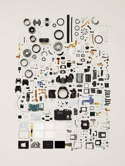 Sony digital SLR camera Things Come Apart by Canadian photographer Todd McLellan makes visible the inner workings of everyday products by dismantling, carefully arranging the components and photographing them. His book, Things Come Apart, presents a unique view of items such as chainsaws and iPods, transforming ordinary objects into works of art