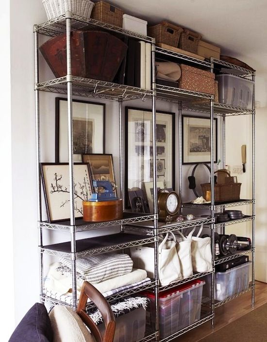 7 Ways To Organize Using Wire Shelving // Metro shelves used for extra storage in the media or family room