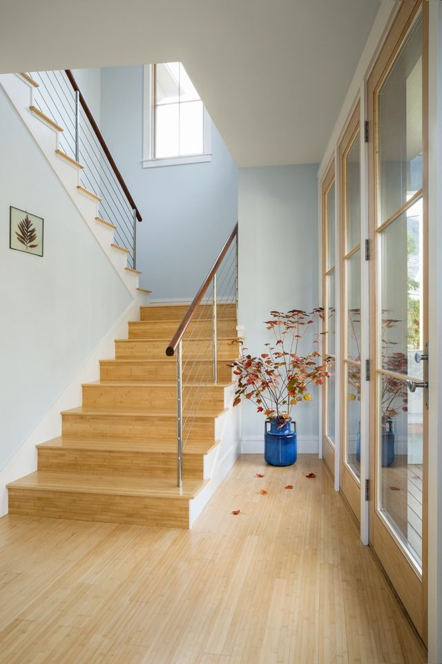An airy front entry features bamboo floors and an abundance of windows.
