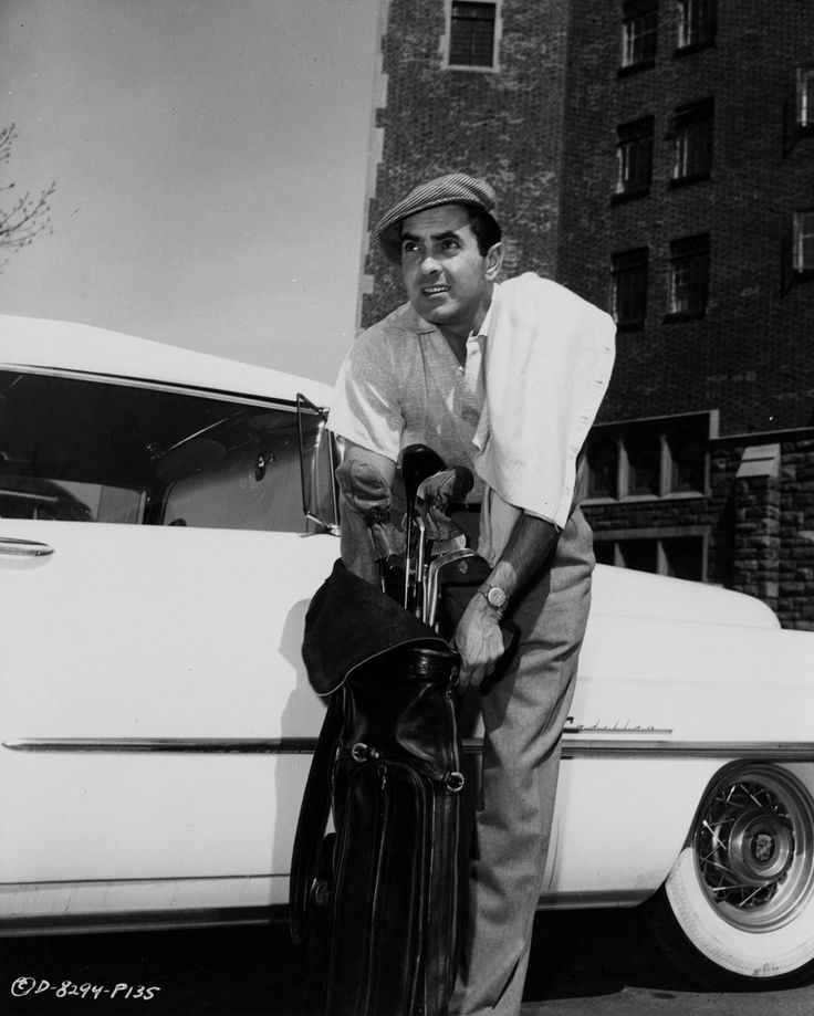 0 tyrone power preparing for golf 1955
