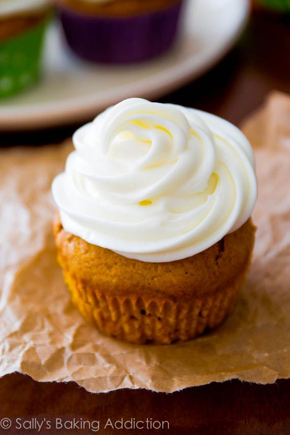 Moist & flavorful spiced pumpkin cupcakes piled high with cream cheese frosting. My favorite pumpkin cupcake recipe!