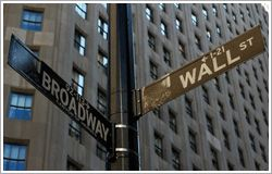 Wall Street ended higher on Tuesday with the Dow Jones Industrial Average hitting a record high due to gains in index heavyweight Wal-Mart. Investors mostly shrugged off concerns related to a war of words between North Korea and the US, and the lack of progress of President Donald Trump's promised tax reforms.