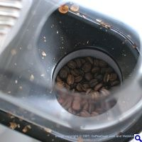 Mind = Blown!  Use an air popcorn popper to air roast your own coffee beans at home!  blows chaff up and out too!