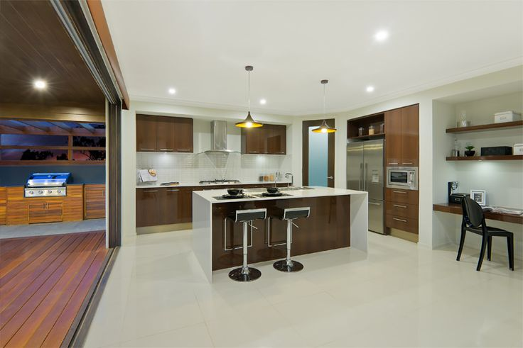 Love how this kitchen goes straight onto the wooden deck. Love the large bifold doors