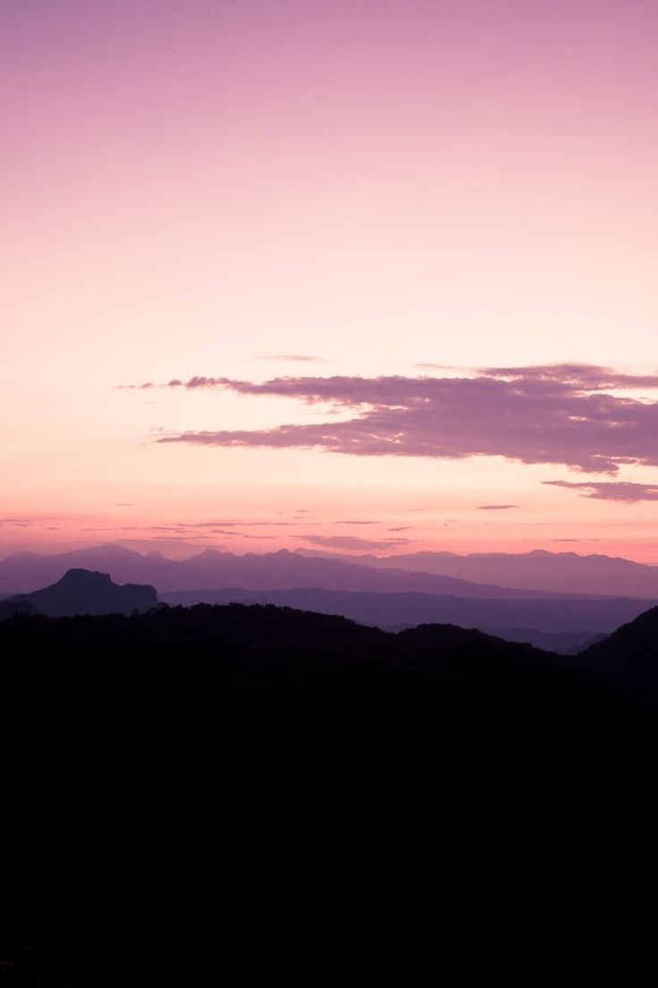 Silhouette of Mountain Area Under Purple Beige Sky during Sunset