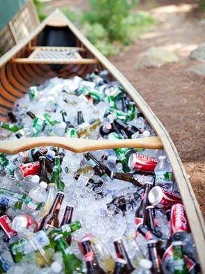 Wooden canoe used as beverage cooler. | See more lodge #wedding details here: http://www.mywedding.com/articles/lodge-wedding-details/