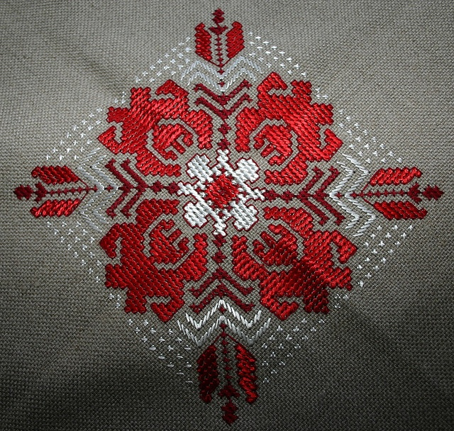 Bulgarian motif on square tablecloth - would make sweet knitting motif