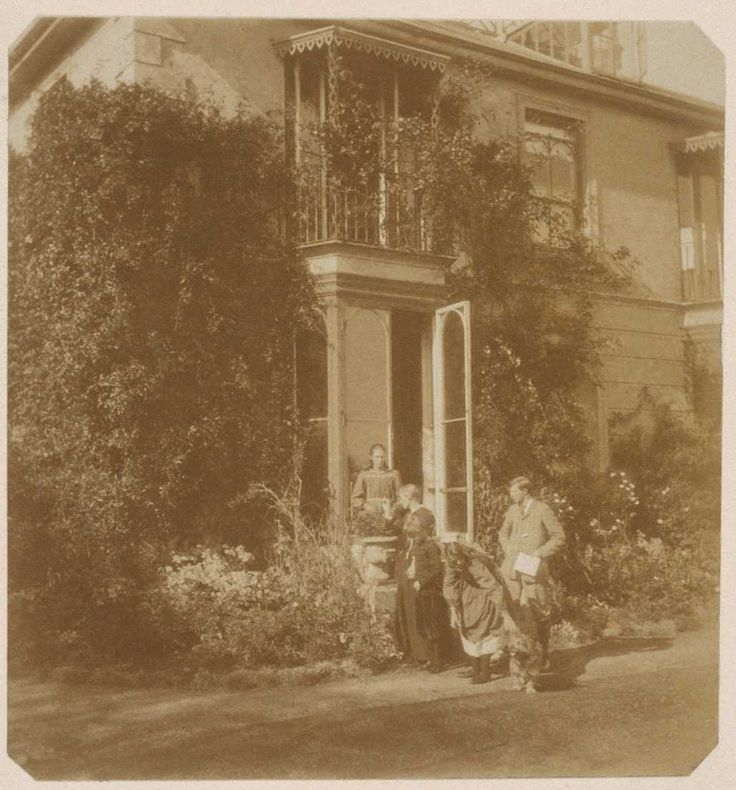 The summers she spent at Talland House were the inspiration for Virginia Woolf's novel To the Lighthouse. There is even a neighboring lighthouse that has a visitor's book that still contains the signature of a ten year old Virginia Stephen. The photo shows Virginia, bending over to pet the family dog, and is surrounded by her siblings and her mother.
