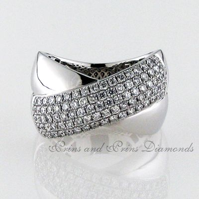 89 = 1.040ctGH/VS – SI round brilliant cut diamonds set on one of the bands of a criss-cross ring design in 18k white gold