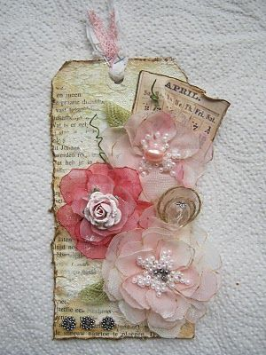 paulien van den bosch: April Tag. Another one using book pages - this is pretty nice overall (a little busy). Again, love the background.