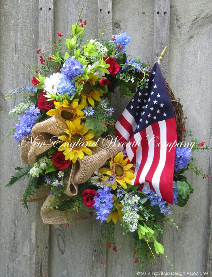 Country Cottage Sunflower Wreath with American Flag. Bright and Beautiful! Sunflowers, Daisies, Roses, Lilacs, wildflowers and greenery in bright yellow gold, cornflower blue, lilac, cherry red and so