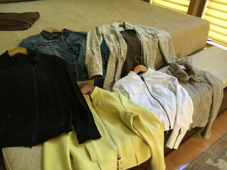 yikes -- i think i have a thing for jackets -- black silk assymetrical bomber, classic denim and white jean jackets, reversible camp with drawstring waist, yellow belt waisted and gold open weave rolled collar --