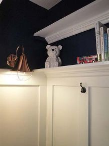 closet turned reading nook and toy storage, bedroom ideas, closet, lighting, shelving ideas, storage ideas, woodworking projects, Sconce added by running a cord around the molding and plugging it into the outlet outside the closet