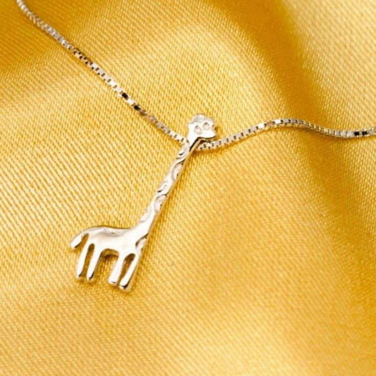 This beautiful giraffe necklace is made from 925 Sterling Silver, and its lovely…