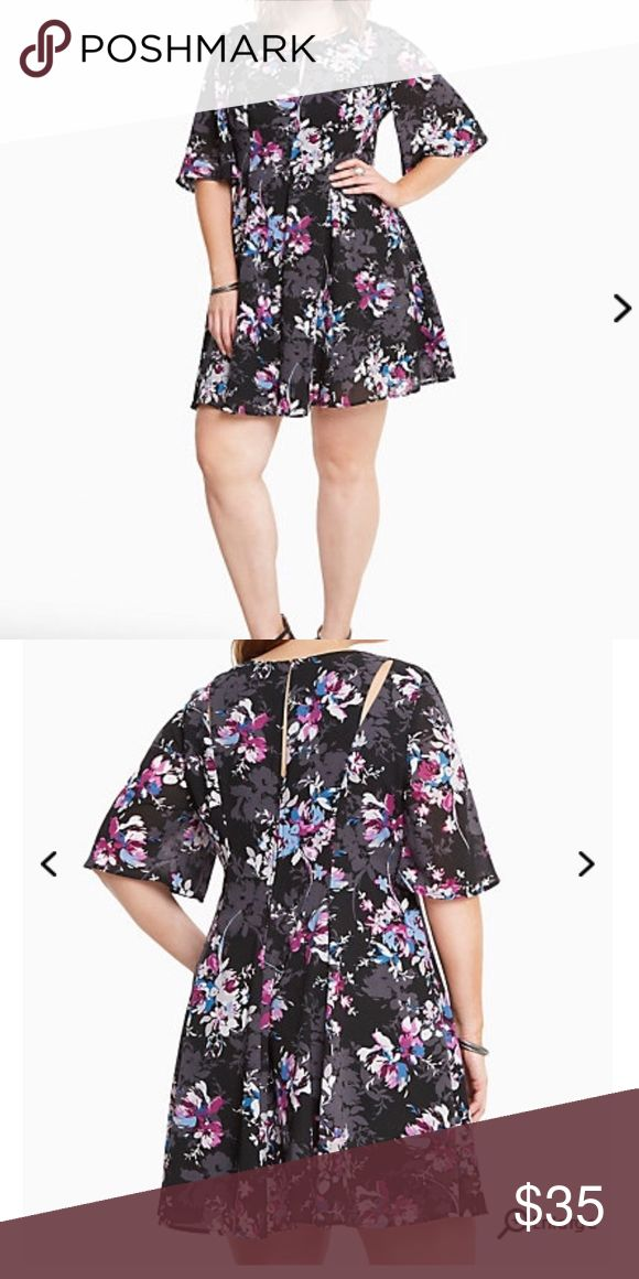 NWT torrid size 22 floral flutter sleeve dress NWT torrid size 22 floral flutter sleeve dress . While the black georgette (complete with curve-defining seams) is keeping it sleek, the multi-color floral print makes no apologies about its love for all things frilly. The flutter sleeves are a bit of a #tbt, but the cutout shoulders are here in the now. torrid Dresses
