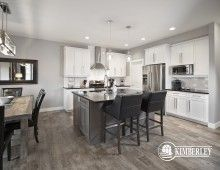 Kitchen. Dining nook. White cabinets, stainless steel appliances. quartz island. Opal in Keswick, by Kimberley Homes.