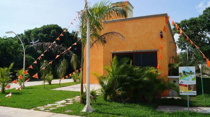 Facade of the model home. Hacienda del Río Custom Homes. Playa del Carmen real estate.