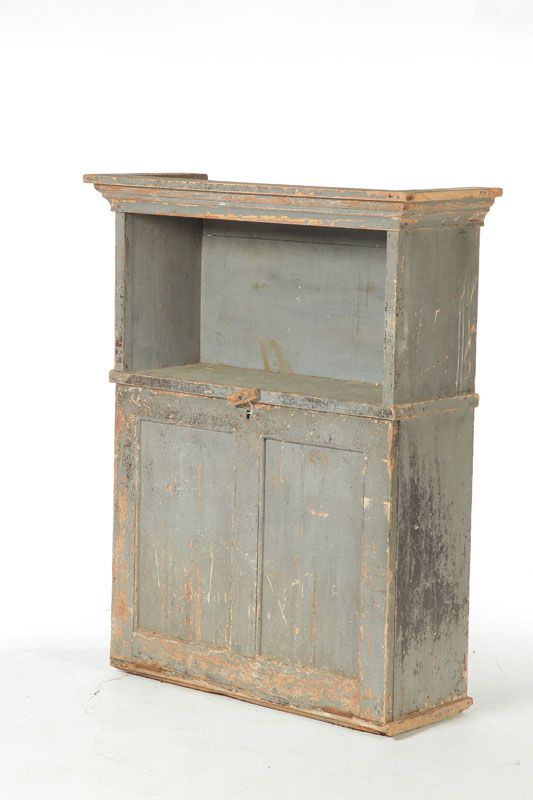 """PAINTED SECRETARY CUPBOARD.  American, 19th century, pine. Either a hanging cupboard or a secretary top, with an upper shelf and a fall front revealing slots and pigeonholes. Old grey paint. 46 1/2""""h. 36""""w. 14""""d."""