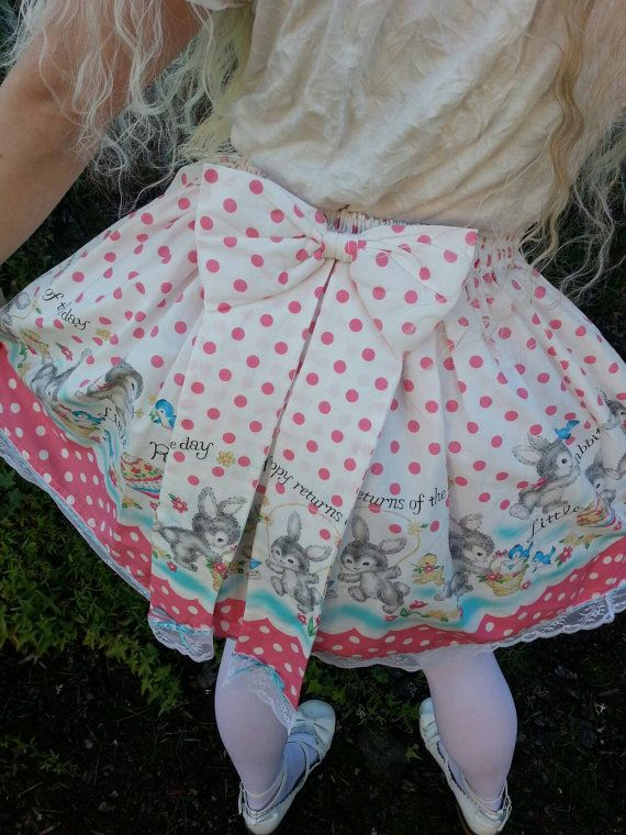 Made of a darling Japanese border print fabric in bright pink and blue. The text says Many happy returns of the day. Happy blue ribbon beads through the vintage lace along the hem. The back bow has long tails with the little rabbits hopping along. Hair bow can be worn as a front bow on your skirt. Two channels of elastic all the way around for comfort.