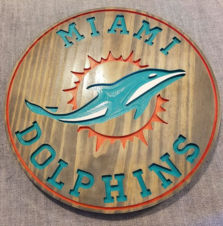 Excited to share the latest addition to my #etsy shop: Miami Dolphins! Wood router sign Painted and stained 16 inch round by 11/16 thick! Perfect for man or lady cave. http://etsy.me/2DSviCp #housewares #homedecor #sports #decor #custommade #wood #carving #handmade