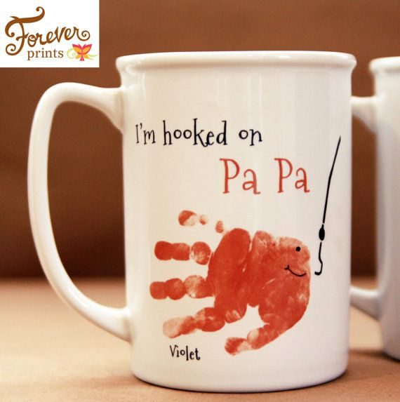 This keepsake is made from your loved one's actual hand and footprints! Keepsake Description: Large and beautiful best describes our 20oz ceramic mug Microwave and dishwasher safe, this mug is intended to be used daily As priced, this mug is one sided. If you would like to discuss a custom designed two sided mug, please contact us. Kiln fired for over 40 hours at 2,000 degrees, the design is guaranteed to never fade or scratch. _______________________________ CUSTOMIZE YOUR DESIGN All of…