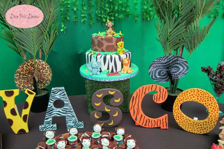 Amazing cake and decorations at a safari birthday party! See more party ideas at CatchMyParty.com!