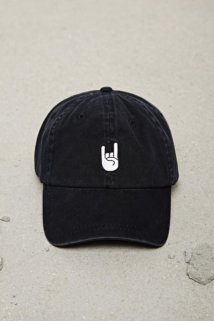 "A canvas baseball cap featuring an embroidered ""Rock On"" hand symbol on the front and adjustable back."