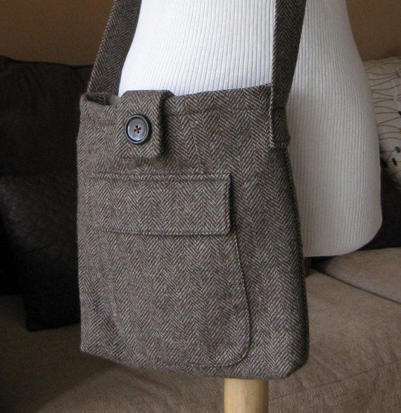 This is the first in a series of eco friendly bags that I have created using upcycled wool blazers. All of the linings are made from the silky lining from the blazer unless otherwise specified. This bag is made from brown wool tweed in a herringbone pattern, and It features a snap closure with a button accent. There is a large flap pocket on either side to carry smaller items. It measures 12 high, 11 wide, and just under 2 deep. It has a 42 long handle with an approximately 18 drop. It can…