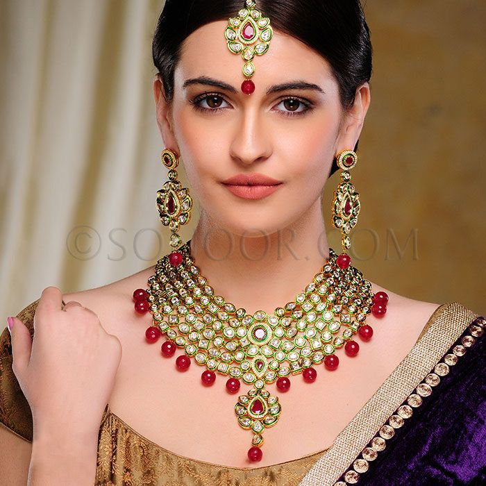 BRI/1/2802 Navya Bridal Set includes Necklace, Earrings, Haath Phool, and Maang Tika in dull gold finish studded with czee polki stones and red jade  $598 £353