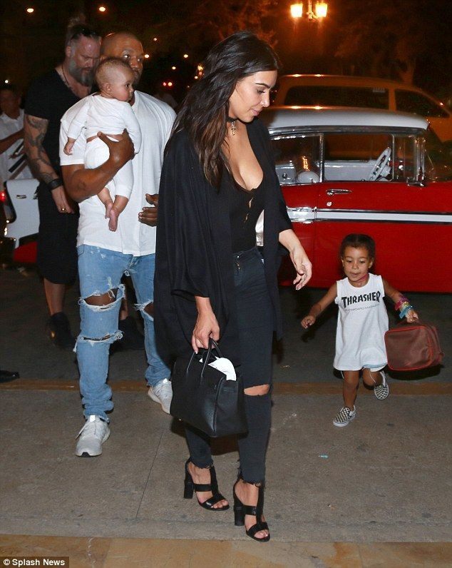 Family holiday: While Kanye took care of Saint, Kim Kardashian looked after their daughter...