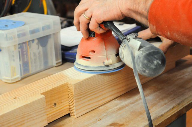 Sand the legs and cross supports with 100- and 120-grit sandpaper. Use a small router and a chamfer bit to ease the corners on the legs and cross supports.