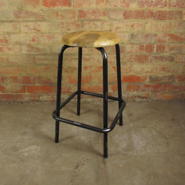 Rustic black bar stool with wooden top. 70cm height. Antiqued finish.