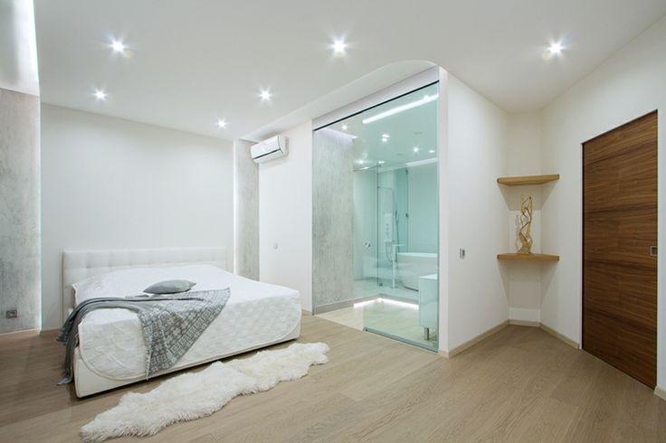 Chambre avec salle de bain avec cloison en verre