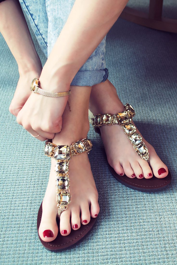 Bling on spring with jewel-toned nails and a pair of Steve Madden Gram sandal. The stylish gold sandals are encrusted in oversized gemstones and feature an adjustable heel strap.