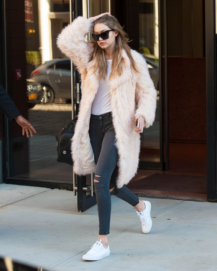March 18, 2016 Spring may be just around the corner, but the frigid temps are holding tight in New York City. Normally we'd be all fussy and impatient about it, but the pink faux fur coat Gigi Hadid wore has us rethinking our stance on the lingering chill. Maybe a little wintry weather isn't so bad—if it means you get to cozy up in a fuzzy beauty like this.