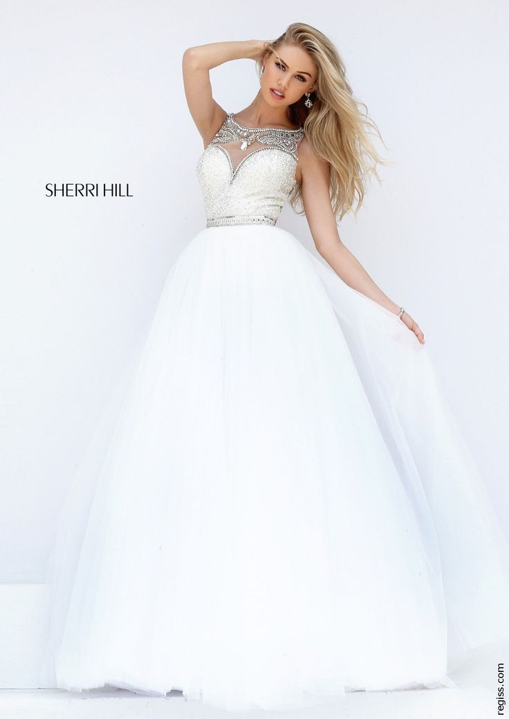 If you are looking to make a statement look no further than this Sherri Hill dress 50562. This dress highlights an embellished illusion high neckline with a fully beaded bodice. A beaded belt around t