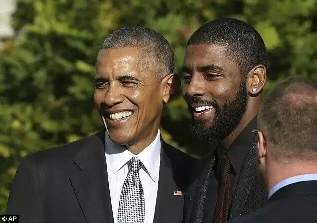 President Obama poses for a picture with Cleveland Cavaliers point guard Kyrie Irving Read more: http://www.dailymail.co.uk/sport/othersports/article-3926678/LeBron-James-Cleveland-Cavaliers-Mannequin-Challenge-Michelle-Obama.html#ixzz4Pokxzqyv Follow us: @MailOnline on Twitter | DailyMail on Facebook