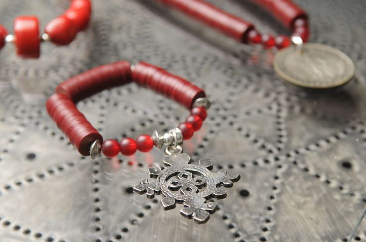 Bracelet made with diguida beads from West Africa + Ethiopian cross. By Tinky. https://www.facebook.com/TinkySonntag