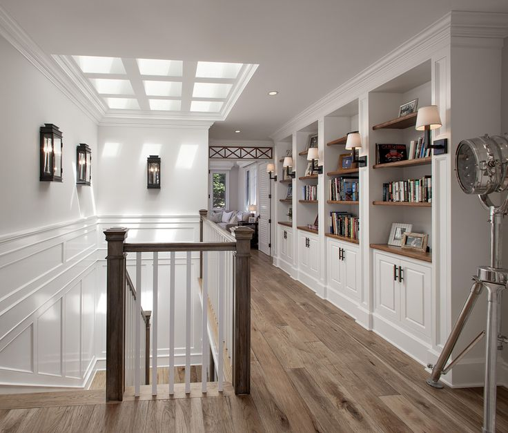 upper hallway, built in bookshelves, natural wood floors, skylights