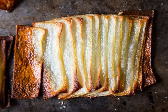 Potatoes slices into domino fans, roasted to a crisp edge and creamy center with clarified butter Francis Mallmann's Potato Dominoes on Food52