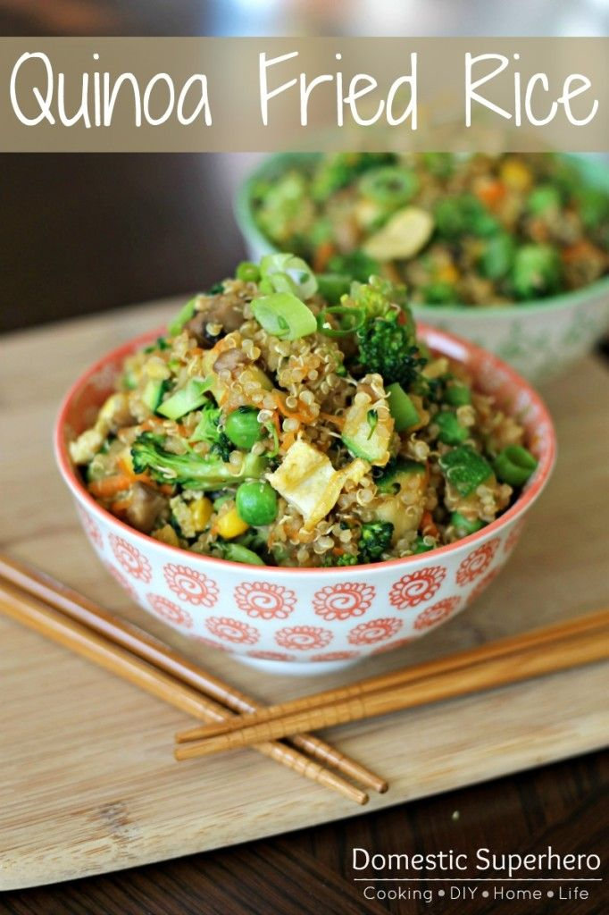 2 tablespoons olive oil, divided 2 large eggs, beaten 2 cloves garlic, minced 1 small onion, diced 8 ounces mushrooms, sliced 1 head broccoli, cut into florets 1 zucchini, chopped 1/2 cup frozen corn 1/2 cup frozen peas 2 carrots, peeled and grated 3 cups cooked quinoa 1 tablespoon grated fresh ginger 3 tablespoons soy sauce 2 green onions, sliced