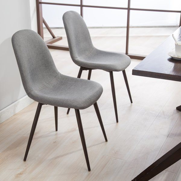 Welcome The Upholstered Dining Chair Into Your Kitchen Or Dining Room For A Perfect Perch From Which To E Fabric Dining Chairs Dining Chairs Teak Dining Chairs