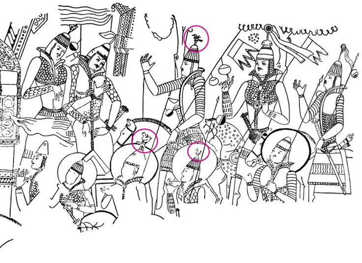 """Doğu Türkistan Kızıl Mağarası duvar Çizimleri. Çizimlerde Türk Uygur Alp'ları resimlenmiş. Ellerinde Kurt Dişli Batrak taşıdıkları görülür. Miğferlerinin üzerinde """"Kuş"""" şekilleri dikkatli bakınca görülebilir. Yırtıcı kuşlar Oğuz boylarının Ongunu sayılırdı. Miğfer başına kuş tüyü takma adeti Osmanlı da da devam etmiştir. Nuray Bilgili"""
