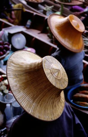 In Asia for example hats protect one from the sun, and by maintaining a light color skin denotes a higher status, e.g., not a peasant.