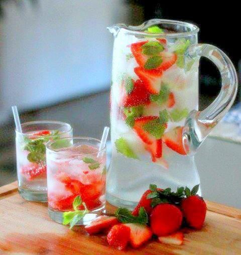 Sparkling Strawberry Mint Lemonade  OR:  Strawberry mint lime: squash 3-4 limes,  6-8 tblsp sugar,  15 mint leaves,  1000 ml/ 4,2 cups fresh cold water,  4-6 strawberries, sliced.  - Squeeze the limes.  - Crush mint leaves with sugar or in blender.  - Mix lime juice & mint-sugar and stir.  - Add fresh water & stir until the sugar has dissolved.  - Serve with strawberry slices & lots of ice.