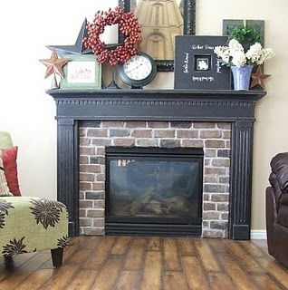 Really cute fireplace...love the brick, the black mantel on the wood floor!