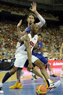 USA guard Kobe Bryant drives past Spain forward Pau Gasol during the first half. Gasol scored 19 points and Bryant had six. - http://www.PaulFDavis.com/success-speaker (info@PaulFDavis.com)